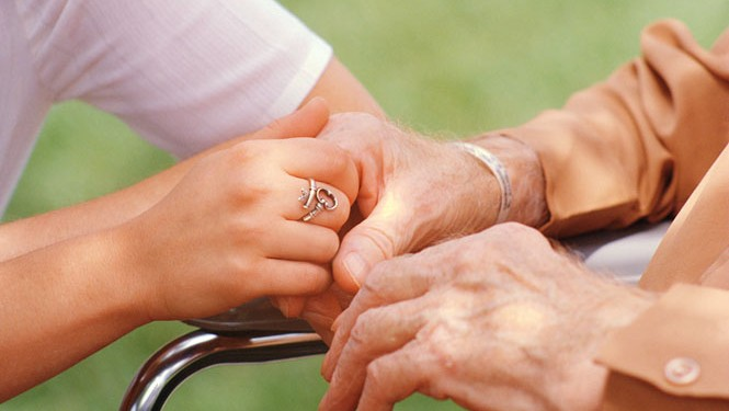 Nurse Holding Elderly Patient's Hand tsc